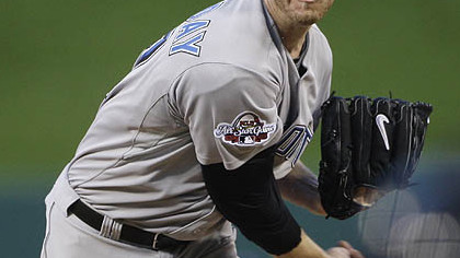 Roy Halladay of the Blue Jays pitches during the first inning.