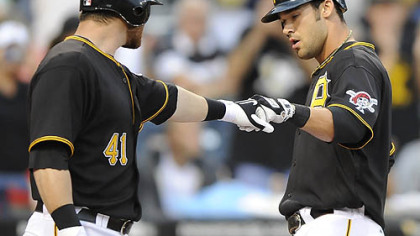 Pirates outfielder Garrett Jones, right, is greeted at home by catcher Ryan Doumit after hitting a solo home run in the first inning.