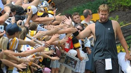 Ben Roethlisberger, making his way to the Steelers trainig camp practice field, high fives fans along the way before afternoon sessions yesterday at St. Vincent College in Latrobe.