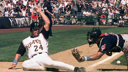 Brian Giles gets by Cleveland Indians catcher Einar Diaz to score the winning run back in June of 2001. Giles scored from second base on a hit by Aramis Ramirez, to beat the Indians, 1-0.