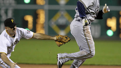 Pirates shortstop Jack Wilson tags out Brewers second baseman Felipe Lopez to end a first inning rundown between first and second.