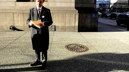 Pittsburgh mayoral candidate Patrick Dowd reviews his notes before addressing the media at the corner of Forbes Avenue and Grant Street, Downtown, today.