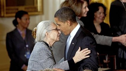 President Barack Obama embraces White House Senior Adviser Valerie Jarrett's mother, Barbara Bowman, yesterday after signing an Executive Order creating the White House Council on Women and Girls.