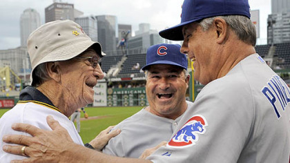 Former Pirates manager Chuck Tanner greets Cubs manager Lou Piniella, right, and first base coach Matt Sinatro after a ceremony honoring the 100th anniversary of Forbes Field last night.