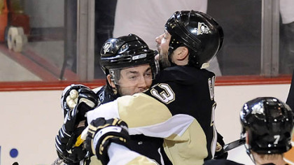 Kris Letang is congratulated by teammate Bill Guerin after shooting the winning goal in overtime against the Capitals in Game 3 of the second-round of the Stanley Cup Playoffs series tonight at Mellon Arena.