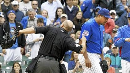 Home plate umpire Mark Carlson, left, ejects Chicago Cubs&#039; starting pitcher Carlos Zambrano, center, as Cubs manager Lou Piniella, right, comes to his aid during the seventh inning of last night&#039;s game against the Pirates at Wrigley Field in Chicago. Zambrano argued that he tagged the Pirates&#039; Nyjer Morgan at home plate.