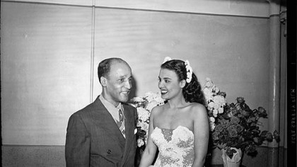 Teddy Horne, and his daughter Lena Horne wearing sequined strapless dress, standing
