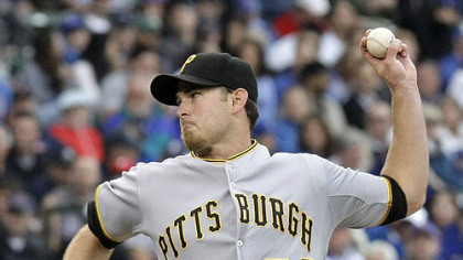 Pirates starting pitcher Zach Duke delivers during the second inning of yesterday's game against the Chicago Cubs at Wrigley Field in Chicago.