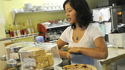 Melissa Santos of Bloomfield bags a customer order at the Dozen Bake Shop in Lawrenceville. The shop has been using Twitter to let customers know what's new.