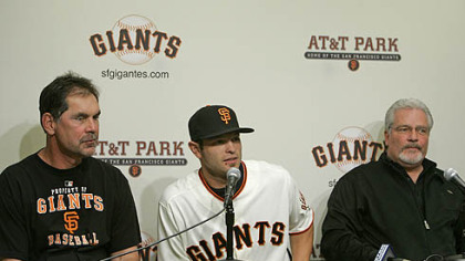 New Giants infielder Freddy Sanchez sits between manager Bruce Bochy, left, and general manager Brian Sabean, right, during a news conference at AT&T Park in San Francisco yesterday. The Giants acquired Sanchez from the Pirates.