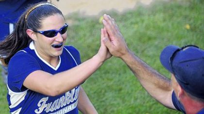 Winning pitcher Ally Vrcek gets a high-five from Franklin Regional head coach Jim Armstrong.
