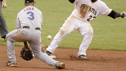 Pirates catcher Robinzon Diaz, gets back to second safely as Mets shortstop Alex Cora gets in front of the pickoff throw from catcher Omir Santos during the eighth inning yesterday.