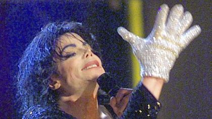 "Michael Jackson sports his trademark glove as he performs ""Billie Jean"" during his ""30th Anniversary Celebration, The Solo Years"" concert at New York's Madison Square Garden, Friday, Sept. 7, 2001."