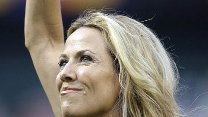 Singer Sheryl Crow waves after singing the national anthem.