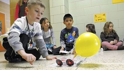 Zach Sauro, a first-grader at J.A. Allard Elementary School in Moon, releases his car powered by a yellow balloon.