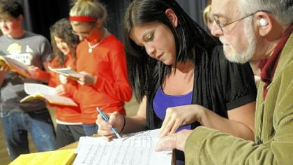 "Katie Aiello looks over a score with John Carosella during a rehearsal for ""Do Black Patent Leather Shoes Really Reflect Up?"" The play is being performed as a fundraiser for the Tami Kunst Scholarship Fund, established by Ms. Aiello for students in the Norwin School District."