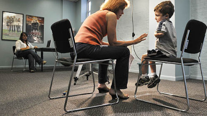 Ethan Davis, 5, of Mt. Lebanon, rehearses his lines with Donna Belajac during a casting call for the feature film &quot;The Next Three Days,&quot; which is scheduled to shoot in Pittsburgh this fall. Dozens of  boys showed up at Ms. Belajac&#039;s casting agency on Market Street yesterday to audition for the roll of the 5-year-old son of Russell Crowe&#039;s character. At left is Missy Haught, an intern at the agency.