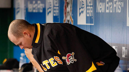 Pirates relief pitcher Steven Jackson sits in the dugout during the bottom of the ninth.