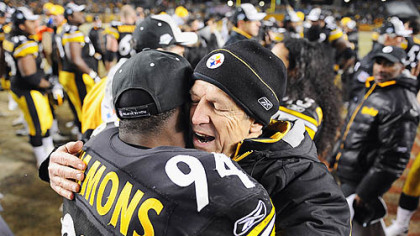 Dick LeBeau celebrates the AFC title at Heinz Field last month with one of his linebackers, Lawrence Timmons. LeBeau just completed his 50th season in the NFL.