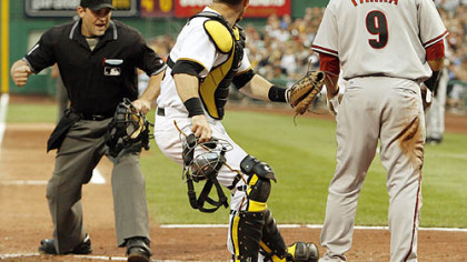 Pirates catcher Ryan Doumit looks as home plate umpire Brian Knight calls Diamondbacks outfielder Garardo Parra out after he tried to score from first base on a double by third baseman Mark Reynolds in the third inning inning.