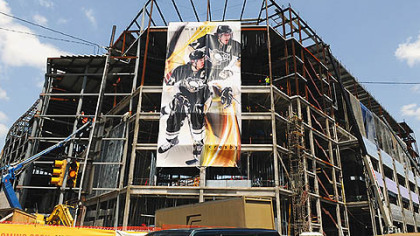 A huge banner of Sidney Crosby and Evgeni Malkin hangs from the new Penguins arena along Fifth Avenue.