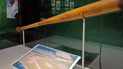 Memorabilia from Forbes Field, including a bat from Roberto Clemente, at the exhibit commemorating the 100th anniversary of Forbes Field at the Western Pennsylvania Sports Museum at the Sen. H. John Heinz History Center.