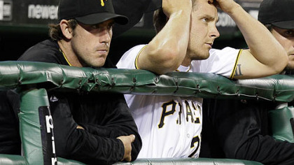 Pirates pitchers Ross Ohlendorf, left, and Kevin Hart watch the ninth inning of a 6-0 shutout by the Diamondbacks at PNC Park last night.