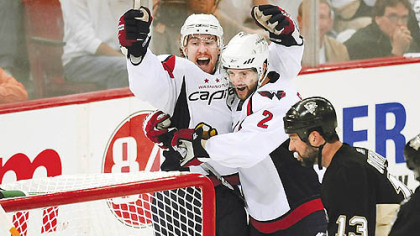 Capitals forward Tomas Fleischmann celebrates his goal with teammate Brian Pothier in the second period Monday night.