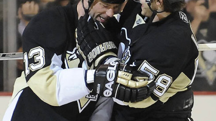 Kris Letang, right, congratulates Bill Guerin's game winner.