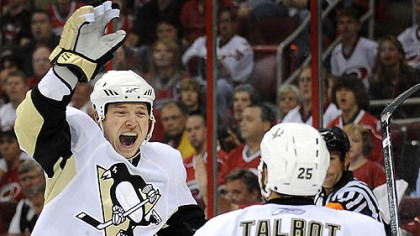 Ruslan Fedotenko celebrates his first-period goal with Max Talbot against the Hurricanes last night at the RBC Center in Raleigh, N.C.
