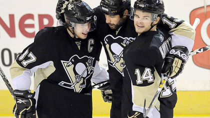 Sidney Crosby and Chris Kunitz congratulate Bill Guerin on his first-period goal against the Capitals in game 6 of the Eastern Conference semifinals Monday night at the Mellon Arean.
