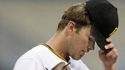 Pirates pitcher Zach Duke adjusts his hat after serving up a third-inning home run to Cubs outfielder Ryan Theriot last night.
