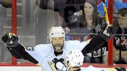 Bill Guerin celebrates his second-period goal with Chris Kunitz against the Hurricanes last night.