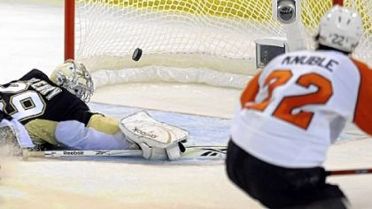The Flyers' Mike Knuble gets a shot past Marc-Andre Fleury in the third period of Game 5 last night at Mellon Arena.