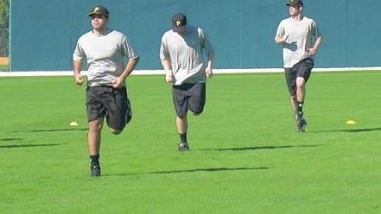 Top prospect Pedro Alvarez, left, participates in a running drill with other minor leaguers yesterday in Bradenton, Fla.