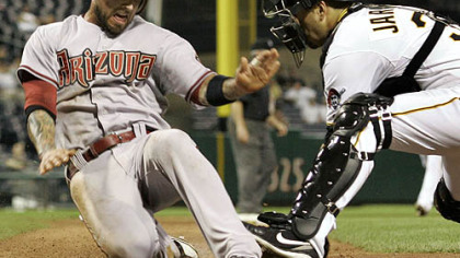 Pirates catcher Jason Jaramillo loses the ball as he attempts to tag Diamondbacks infielder Ryan Roberts during the eighth inning.