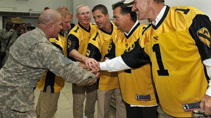U.S. Army CSM Larry Wilson (L) joins hands with NFL coaching legends (L-R) Jon Gruden (formerly Tampa Bay Buccaneers and Oakland Raiders), Tom Coughlin (NY Giants), John Harbaugh (Baltimore Ravens), Jeff Fisher (Tennessee Titans) and former Steelers Coach Bill Cowher  prior to a USO appearance at Forward Operating Base Warrior near Kirkuk, Iraq, Thursday.