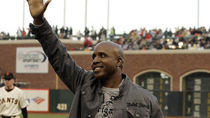 Former Giants and Pirates left fielder Barry Bonds waves to fans after a pre-game tribute to Sue Burns, a part owner of the Giants and friend of Bonds who lost her fight with cancer.