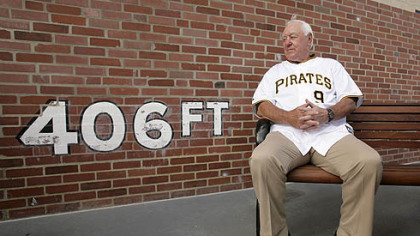 Pirates Hall of Famer Bill Mazeroski sits in front of a replica of the left field wall at Forbes Field, at PNC Park before last night's game against the Cubs. Yesterday marked the 100th anniversary of the first game to be played in Forbes Field.