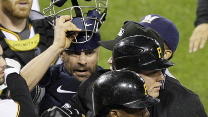 Pirates pitcher Jeff Karstens, partially blocked facing right, is helped out of an altercation with Brewers catcher Jason Kendall, by teammate Andre McCutchen (22) during the eighth inning.