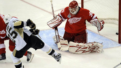 Penguins center Max Talbot scores against Red Wings goaltender Chris Osgood in the second period of Game 7 of the Stanley Cup Final. The game set a local television ratings record.
