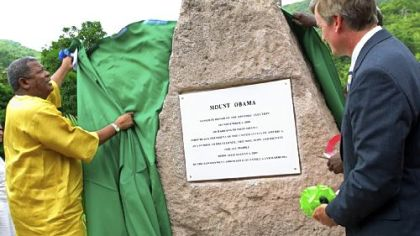 "Antigua and Barbuda's Prime Minister Baldwin Spencer, left, unveils a stone monument and plaque honoring President Barack Obama as Brent Hardt, charge d'affairs of the U.S. embassy in Barbados, looks on during a ceremony naming Antigua's highest mountain ""Mount Obama"" in St. John's, Antigua, on Aug. 4. The small Caribbean nation celebrated the American president on his 48th birthday and saluted him as a symbol of black achievement."