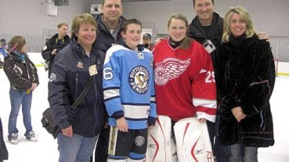 From left, Trina Crosby, Troy Crosby, Austin Lemieux, Taylor Crosby, Mario Lemieux and Nathalie Lemieux pose for a photograph at a peewee tournament last month in Quebec where Austin&#039;s and Taylor&#039;s teams met in a special exhibition game.