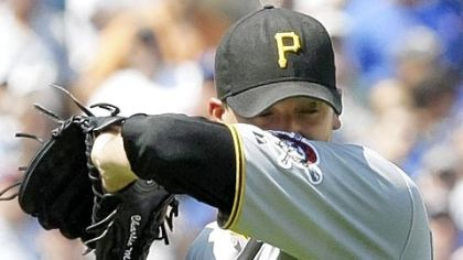 Pirates starting pitcher Charlie Morton wipes sweat from his face during the second inning of Friday's loss to the Cubs.