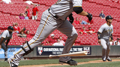 Pirates catcher Jason Jaramillo watches his RBI single hit off Reds pitcher Carlos Fisher in the seventh inning of game 1.