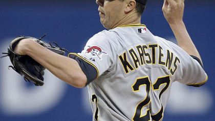 The Pirates' Jeff Karstens delivers against the New York Mets in the first inning last night at Citi Field in New York.