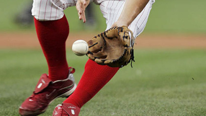 Phillies pitcher Joe Blanton fields a ground ball hit by Pirates catcher Ryan Doumit in the first inning of last night&#039;s game.