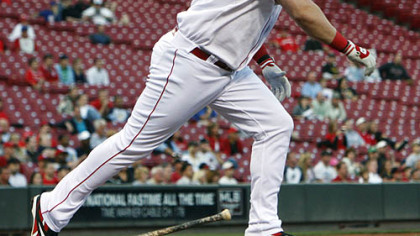 Reds outfielder Jonny Gomes watches his ground-rule double hit off Pirates pitcher Paul Maholm, scoring second baseman Brandon Phillips in the first inning of the second game.