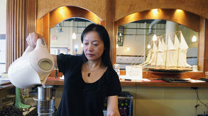 Jade Shang makes Vietnamese iced coffee at Vietnam's Pho in the Strip District.