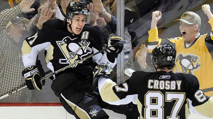Evgeni Malkin celebrates his third-period game-tying goal with teammate Sidney Crosby.